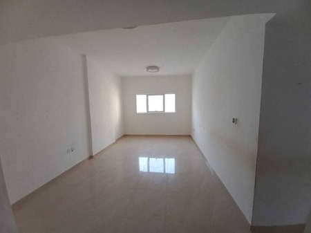 For rent in Ajman, a one-bedroom apartment, a second inhabitant, central air conditioning, close to all services, behind the Grand Mall