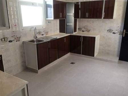 Super Deluxe 3 bed rooms with huge living area and maids room near to market in villa at Al Falah City